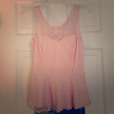 Light/Rose Pink Lace Peplum Tank Top Adorable pink tank top made of lace with soft underlayer. I don't know the brand, but I put a picture of the tag, so if anyone knows the brand please let me know! Three Pink Hearts Tops Tank Tops