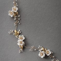 Obsessed with this floral vine!  Freshwater pearls and handcrafted flowers pair perfectly with a lace wedding gown and loose updo xx  #bridalheadpiece #hairvine #percyhandmade #floral #weddinghair #bridalhair #hair #updo #weddingdress #lacedress #flowerheadpiece #flowercrown