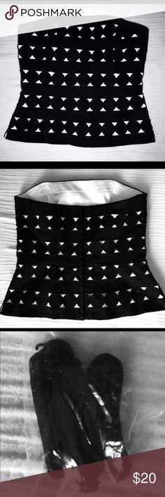 "White House Black Market Black Eyelet Bustier Top Black and white dual-layer bustier (black eyelet overlay on white silky backdrop lining) by WHBM in SIZE 4, with optional adjustable straps & wrap-around belt tie. Fitted silhouette style. Silicon along front & back for non-slip. Self-piping to accentuate & support curves Invisible back zip w/ hook & eye closure. Fully lined.  Now that I'm a stay-at-home mommy, I no longer have a use for my ""working professional"" wardrobe.  I have dozens of…"