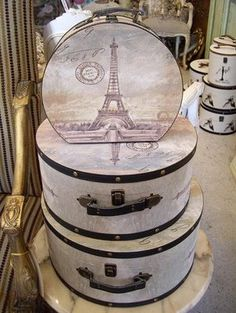 Paris hat box  I have seen these in Homsense stores. Who says storage has to be boring!