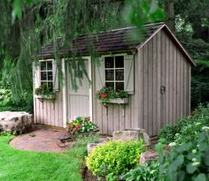 Beautiful Salt Box Style Shed. Vertical slats on facade means it would blend well with a fence if you don't want to draw attention to it.