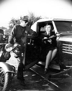 A meter maid and a motorcycle officer for the Glendale Police Department, circa 1930s. Glendale Central Public Library. San Fernando Valley History Digital Library.