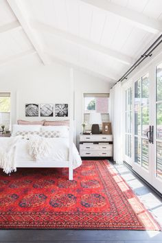 White ceilings and walls with dark floors and oh, that rug!