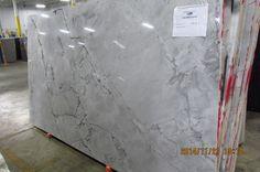 Super White Supreme - Omicron Granite & Tile. Love this with gray or white cabinets