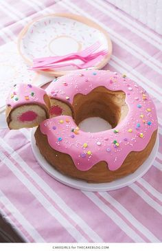 Giant Donut Cake! Learn how to make this adorable, sprinkle-coated, giant donut cake with a simple step-by-step tutorial | by Cakegirls for http://TheCakeBlog.com