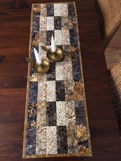 Batik quilted table runner with warm grey, beige, brown and black tones.