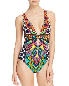 Nanette Lepore gives the classic swimsuit a global touch with its tribal-inspired beadwork and ikat print. The crisscross straps at the front and back lend a contemporary feel.   Nylon/elastane   Hand