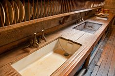 Castle Drogo (National Trust) - Devon  Teak draining surfaces, kitchen sinks (middle one made also made in teak), and wooden plate racks.