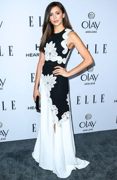 NINA DOBREV wears a black-and-white lace-printed dress and box clutch at Elle's Women in Television dinner.