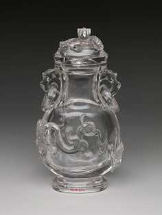 Vase with Dragons  ||  Period: Qing dynasty (1644–1911) Date: 18th century Culture: China Medium: Rock crystal Dimensions: H. 7 5/8 in. (19.4 cm) Classification: Hardstone Credit Line: Gift of Heber R. Bishop, 1902 Accession Number: 02.18.821a, b This artwork is part of Colors of the Universe: Chinese Hardstone Carvings