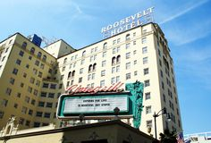 """My Image of Jenny Holzer truism in Hollywood a top of the Roosevelt Hotel on the Cinegrill marquee """"Expiring for love is beautiful but stupid"""" During West of Rome's Women in the City, 2008"""