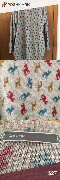 Grey Sweater with multicolored deer print Oversized L grey sweater covered in an adorable multicolor deer print.  Cozy, comfortable, soft AND has pockets.  NWOT! Cherish Sweaters Crew & Scoop Necks