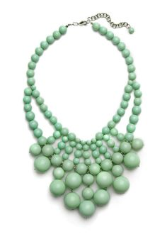 Love the way this necklace looks like it could fill up the space of a low-neck shirt.