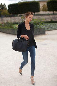 Karmen Pedaru wears a black top, blazer, skinny jeans, Valentino heels, and a Givenchy bag