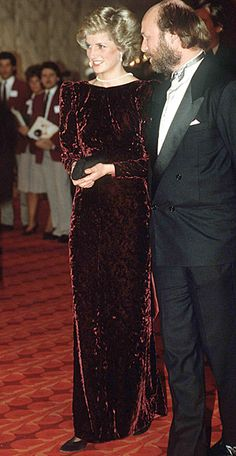 1985   Diana wore this wine velvet Catherine Walker dress to a London premiere. Although it looked conservative from the front, the gown had an open back that the princess accentuated with a long pearl necklace worn backwards.