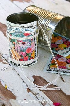 happy may day make flower baskets from tin cans, crafts, flowers, gardening, Tin cans seed packets and string combine to create darling little flower baskets buckets for May Day giving