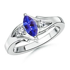 Marquise Tanzanite and Round Diamond Split Shank Ring - Love the setting, but better if in emerald... course, they don't have it in emerald because they suck. :P
