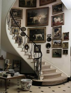 Gorgeous Gallery Wall sweeping up the Staircase..Antique Dog Paintings