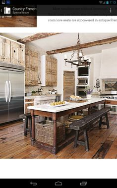 Farm kitchen beautiful kitchen table / island. love the basket.