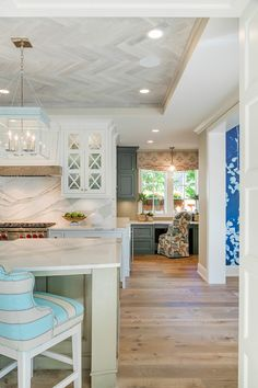 Kitchen Ceiling herringbone made of rustic reclaimed wood reminiscent of driftwood. Wall paint color is Revere Pewter by Benjamin Moore.