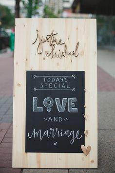 wood cut wedding sign, photo by Blake Loates http://ruffledblog.com/intimate-edmonton-wedding #signs #chalkboard #weddingsigns