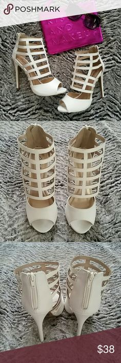 White cage pumps Ummm can we say sexy?!? Be the envy of everyone in the room in these white cage pumps.  Zips up the back.   Heel height is 4.75 inches Shoes Heels