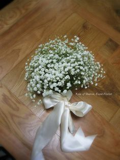 Baby's Breath Bouquet. I'd love a bouquet with baby's breath(festivity), lily of the valley(humility, chastity, sweetness, purity), and forget-me-not flowers(remember me forever).