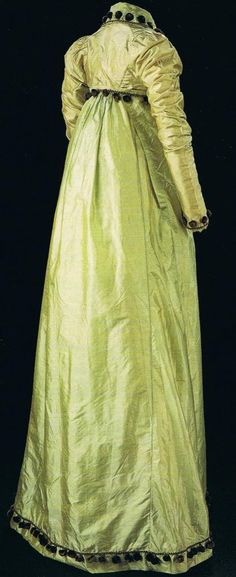 This delightful ensemble of Spencer & matching dress was popular c. 1807-1810. The dress is taffeta, lined with British cotton. The green chenille pom-poms dance along the hem of the dress! I have started the dress in butter coloured silk  will make spencer with the same material