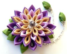 Kanzashi fabric flower hair clip. Shades of purple toffee and