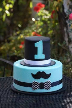 Cute birthday cake with mustache and top hat