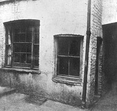 Photograph taken the day of the murder of the outside of Mary Kelly's room. The rather low, smaller window on the right is the one Bowyer and McCarthy looked through. On the original print it appears that both panes of glass on the right side of this window are broken. The photograph was taken by the photographer brought in by the police. This building was demolished in 1928