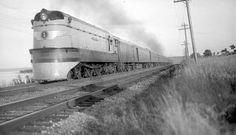 Train No. 101, the Hiawatha, led by a streamlined 4-4-2 class A steam locomotive, passes near Red Wing, Minnesota on August 4, 1937.