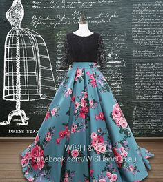 This is a one piece prom dress, set with a lace bodice in black and a full skirt in bold floral prints. The bodice is capped with a bateau neckline and has 3/4 sleeves. Pleated skirt with bold floral print billows to the ground with a sweep train.  + Fully lined - Yes (except the sleeves) + Closure - Closet/ Lace Up Back + Boning - Yes + Built-in bra - Yes + Fabric - Lace and satin + Colour - as per images + Sizing - Custom, measurements will be required once the purchase is confirm...