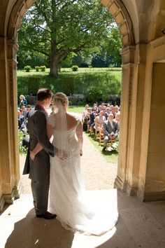 Garden wedding ceremony viewed from the ceremony arch out on to the guests