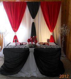 A black and red backdrop and head table design by decorative essentials