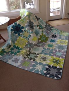 Quilt pattern: Starburst Cross by SewCraftyJess Colors by design-seeds.com Made for Karen for NCSU graduation Most fabrics from Linderella's