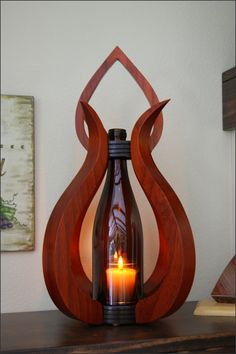 We handcraft each of our wooden centerpieces ourselves in our workshop using a variety of hardwoods. This wood centerpiece lantern is crafted with a combination of two gorgeous hardwoods and finished with a crystal-clear gloss lacquer finish. The globe is a repurposed 750 ml wine bottle.