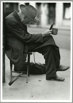 Beggar, New York City  Photo L.W. Hine  Social conditions in the U.S 1990-1937  NYPL Digital Gallery