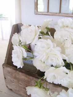 Beautiful white blooms inside a reclaimed wood box.