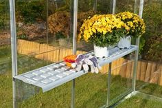 """Greenhouse Shelf Kit . $59.99. This durable, light-weight shelf system attaches quickly to the inside frame of the greenhouse. It can easily be re-positioned for your changing needs. Each kit Includes three aluminum bracket supports and two 24"""" x 10"""" overlapping shelf trays. Fits both Snap & Grow or Multi Line Greenhouses."""