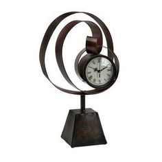 "Pairing metallic inspiration with artful intrigue, this beautifully crafted design adds a chic finishing touch to your den, dining room, or master suite.   Product: ClockConstruction Material: MetalColor: Antique bronzeDimensions: 16.5"" H x 10"" W x 5.5"" D"