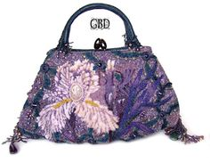 What a beautifully done purse! I can't image ever going some place where I'd be able to use it though. ~~ Bead embroidered handbag by Guzell Bakeeva who lives in Moscow.