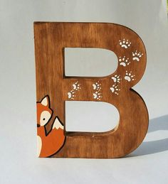 "Natural Pine 8"" Wooden letters, in Wooden Letters for Nursery, Woodland Nursery Decor, Woodland Creatures, Rustic Nursery Decor, Free Standing Letters, Nursery Decor Fox Deer Helvetica font, which are hand stained on all sides with a Walnut Stain. Then, a woodland creature and its tracks are hand painted on each letter."