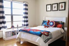 marvel bedroom A modern superhero bedroom for boys with a classic monochrome color scheme and pops of color, featuring the Marvel Avengers characters throughout. Boys Superhero Bedroom, Marvel Bedroom, Kids Bedroom Boys, Big Boy Bedrooms, Boy Rooms, Teen Bedroom, Little Boy Bedroom Ideas, Cool Bedrooms For Boys, Kids Room