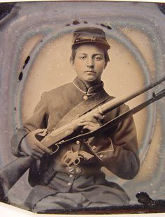 """""""Unidentified young soldier in Union uniform holding musket with Prescott revolver in belt."""" Library of Congress."""