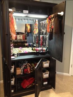My husband took an old TV cabinet and made it into a jewelry armoire for me! He put a mirror on the back wall and lights on top. He put three strips of cup hooks around the side walls to hang necklaces and earrings, towel bars on the doors for scarves, more divider boxes on the counter top for pins, rings, watches and some bracelet holders too. In the lower cabinets (where the DVD trays used to be) he put shelves with baskets for belts and socks plus some shelves for handbags too. He's my…