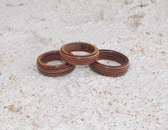 Laminated wood veneer rings by DonBurdaDesign on Etsy  https://www.etsy.com/listing/244030089/laminated-wood-veneer-rings?ref=shop_home_active_1