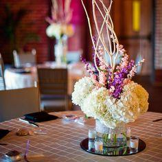 small hydrangea centerpiece | round cylinder vase | white hydrangeas | pink and purple larkspur or snapdragons? | white manzanita branch | bling rhinestone ribbon wrap trim on vase