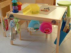 Turn a simple child's play table into a creative workstation using kitchen accessories from IKEA (it's in Italian; but scroll down and there are lots of pictures LOL)