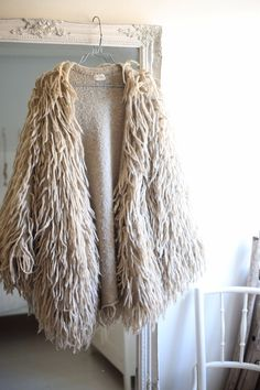 I would 100% wear this - even though it kind of reminds me of the rugs that old people always have in their bathrooms. \('-')/
